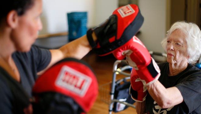 Patricia Sundstrom, 85, throws a punch as she works out with trainer Susan Gilmore at The Bodysmith in downtown Springfield during a Rock Steady Boxing class on Wednesday, June 15, 2016.
