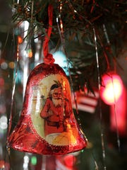An antique ornament hangs on the main tree in the parlor of the Hearthstone Historic House in Appleton on Wednesday. The Eugene Pierce family lived in the home from 1943-1963, and traditionally set up and decorated a 10-foot tree in the parlor. Dan Powers/USA TODAY NETWORK-Wisconsin
