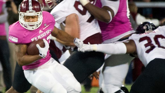 Xavier Hall and the New Mexico State lost 52-7 at Aggie
