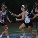 From left, Pearl River's Kelly Ann Henry (21) tries to get around Bronxville's Sophia Anagnostakis (11) during  the Section 1 Class C championship game at Mahopac High School May 26, 2016.