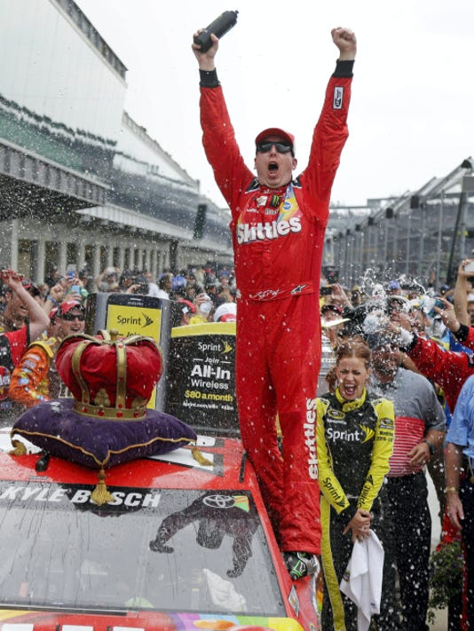 Kyle Busch celebrates Sunday after winning the Brickyard 400 at Indianapolis Motor Speedway in Indianapolis. It was the third straight NASCAR Sprint Cup victory for Busch, who also won the Xfinity Series race at Indy.