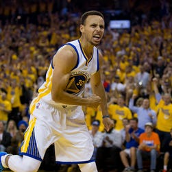 Golden State Warriors guard Stephen Curry (30) reacts after scoring against the Oklahoma City Thunder during the second quarter in Game 5.