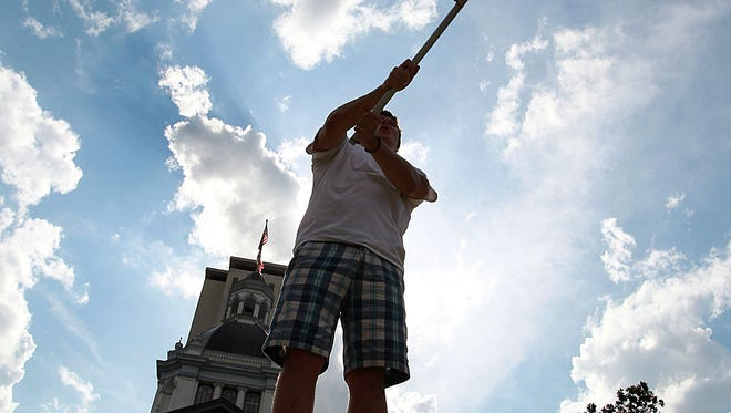 A gay marriage supporter waves a flag outside of the Old Capitol building.