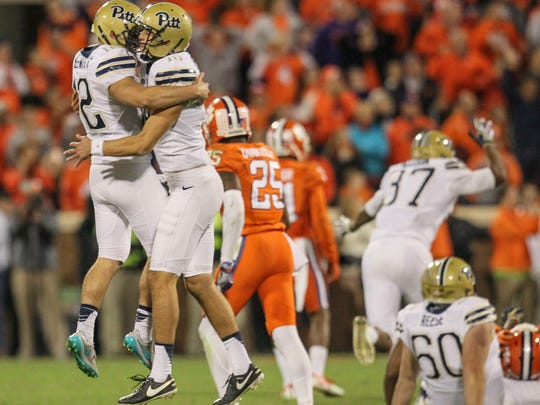 Pitt kicker Chris Blewitt, left, is congratulated by