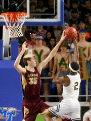 RiverdaleÕs Brayden Siren (35) blocks a shot made by Northeast's Quinton Cross (2) in  the quarterfinals of the TSSAA Boys State Basketball Tournament on Wednesday, March 14, 2018, at MTSU.
