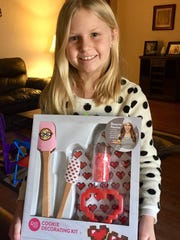 Nikki Goodgion, 9, has started a baking business and gets her inspiration from a YouTube baking channel of Rosanna Pansino, who also has a line of baking tools.