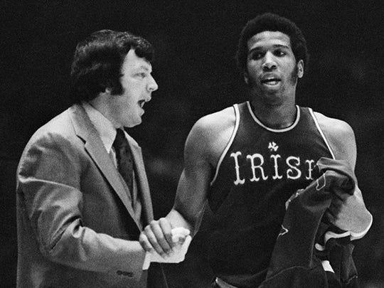 Notre Dame coach Digger Phelps congratulates his star junior Adrian Dantley in 1976.