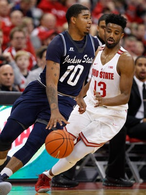 Jackson State forward Sherron Wilson, left, works against Ohio State guard JaQuan Lyle during an NCAA college basketball game in Columbus, Ohio, Wednesday, Nov. 23, 2016. Ohio State won 78-47.