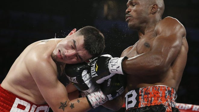Timothy Bradley lands a shot to the head of Brandon Rios during their fight on Nov. 7, 2015, in Las Vegas. Rios, an Oxnard resident, was knocked out. He will make his first trip back to the ring on June 11.