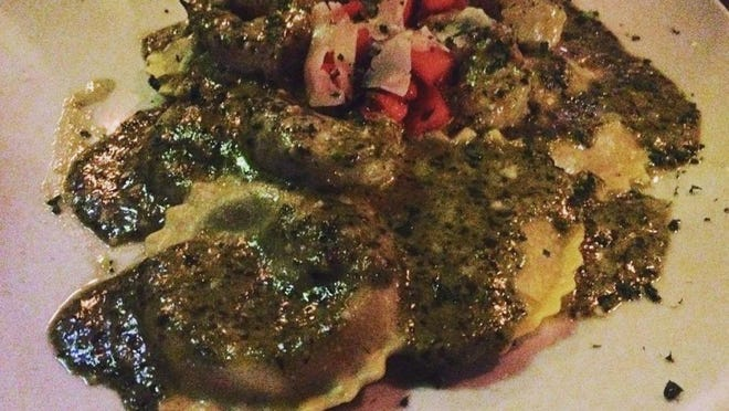 Manatee Island's spinach ravioli with shrimp was large pasta spheres stuffed with spinach and ricotta cheese in a creamy, basil pesto sauce topped shrimp, chopped tomatoes and shaved Parmesan cheese.