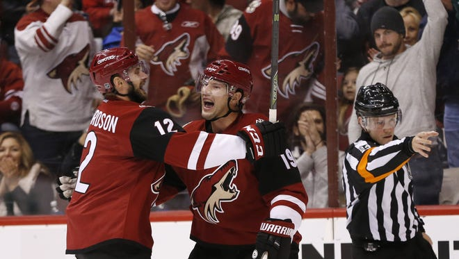 Arizona Coyotes forward Shane Doan (right) celebrates with forward Brad Richardson after scoring a goal against theToronto Maple Leafs during the first period at Gila River Arena in Glendale December 22, 2015.