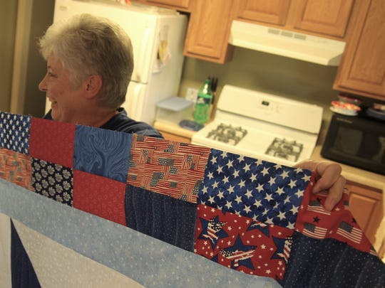 Jane Potter, a quilter for 12 years, shows off the beginnings of a quilt that she started Monday morning. The quilt will be given to a veteran as part of the Quilts of Valor organization.