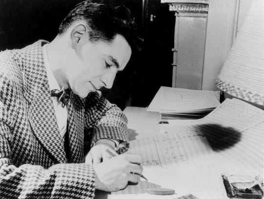 A young Leonard Bernstein composes a song.