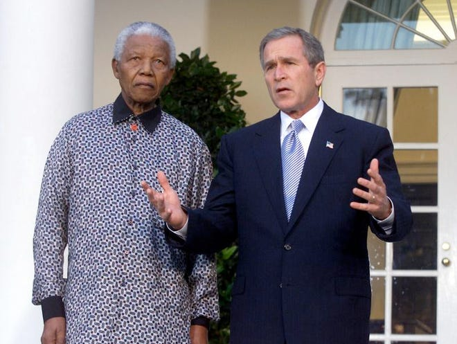 President Bush, right, along with Nelson Mandela, who visited him in the Oval Office, Nov. 12, 2001 at the White House. Mandela died Thursday in South Africa.
