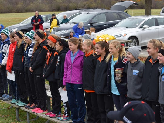 The top 15 finishers at the D1 girls cross country