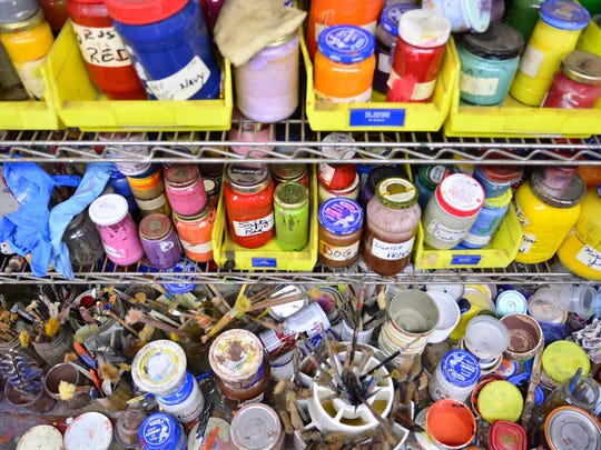 Jars of oil paint are labeled with custom names like dog, humming bird and salty red.