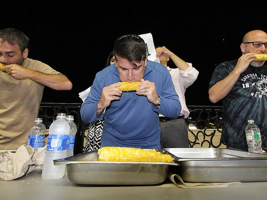 A corn-eating competition at the Meadowlands Racetrack in East Rutherford draws an audience to the site.