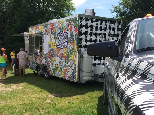 Burlington School Food Project's new Fork in the Road food truck makes it debut Saturday at Oakledge Park. Burlington High School alumna Abby Manock painted the donated truck and trailer.