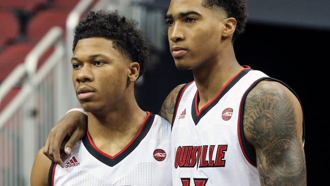 Dwayne Sutton, left, and Ray Spalding, right, pose for a photo during the University of Louisville basketball media day on Tuesday afternoon.October 11, 2016
