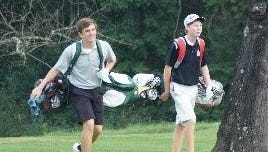 Chris Dunne, left, of McNicholas and friend Chris Mazzaro, right, of New Richmond walk up the fairway at Stillmeadow Country Club.