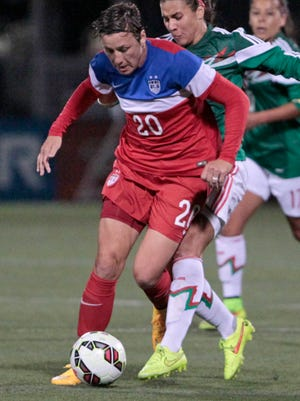 USA's Abby Wambach is run into by Mexico's Nayeli Rangel during a game in Rochester this past September.