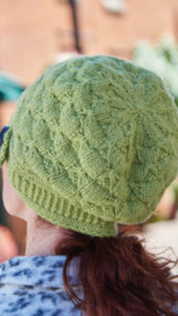 This close-up of the Verdure Buttoned Cloche shows the Bow Stitch really well.