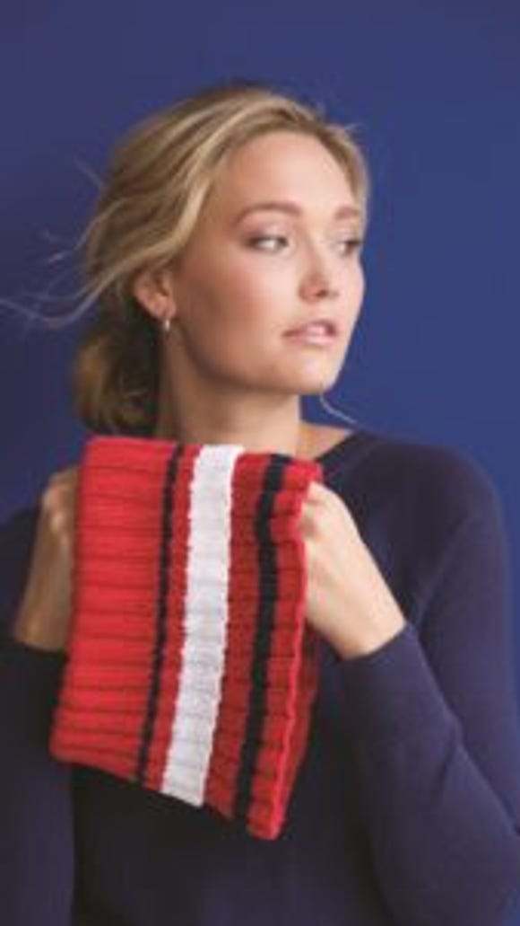 The cowl is knitted on a circular needle with the top turned down as a collar.