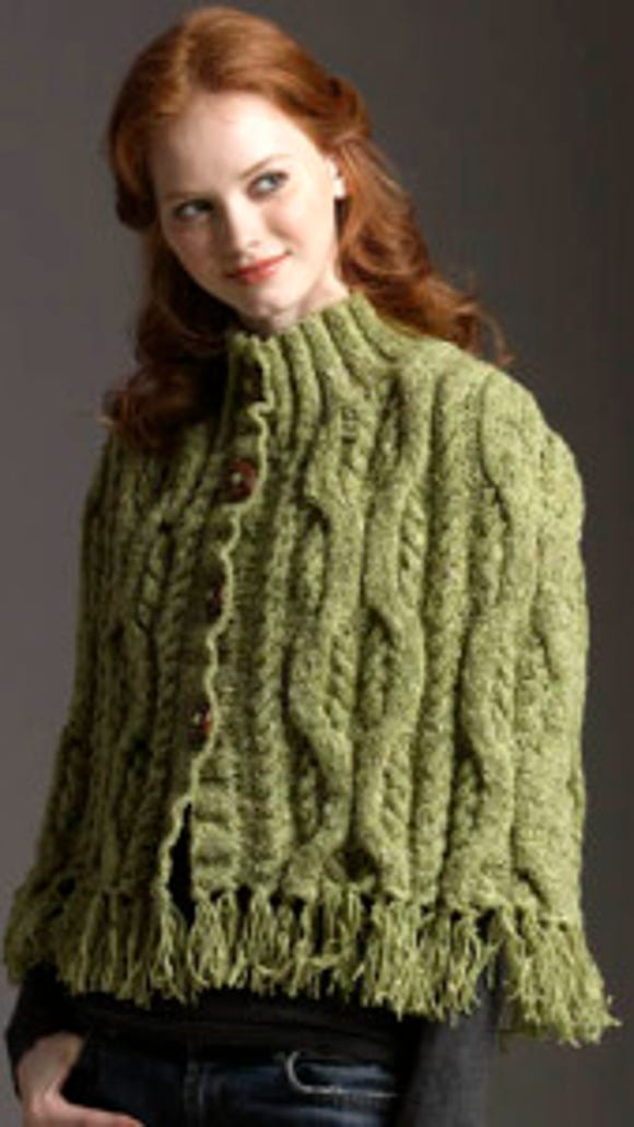 This cabled cape is designed to be knit with Donnegal