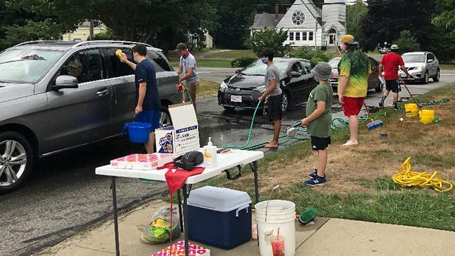 Jason Weldon and fellow Boy Scouts host an eye glass collection and car wash, in West Boylston, in support of his Eagle Project.
