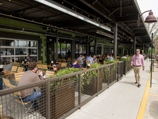 The patio area that connects the recently closed Cochon
