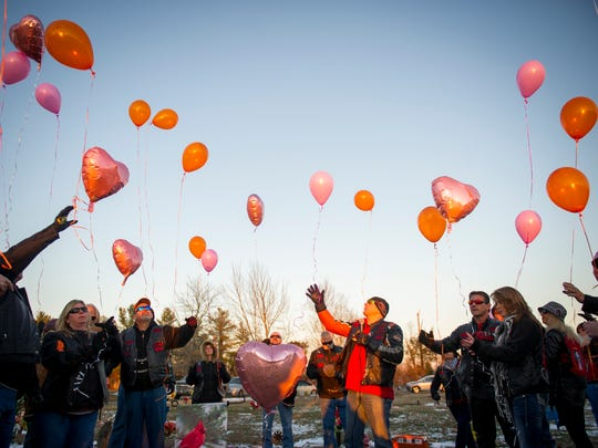 Members of the Shepherds Riding Club release pink and orange balloons in memory of Channon Christian at memorial held at Highland West Cemetery on Saturday, Jan. 7, 2017.