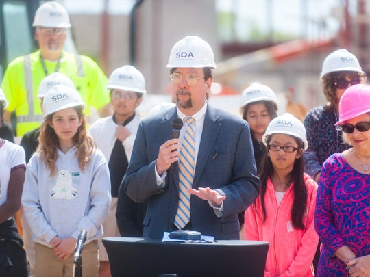Charles McKenna, CEO of the New Jersey Schools Development Authority, speaks during the beam signing of Lincoln Avenue Middle School on Thursday.