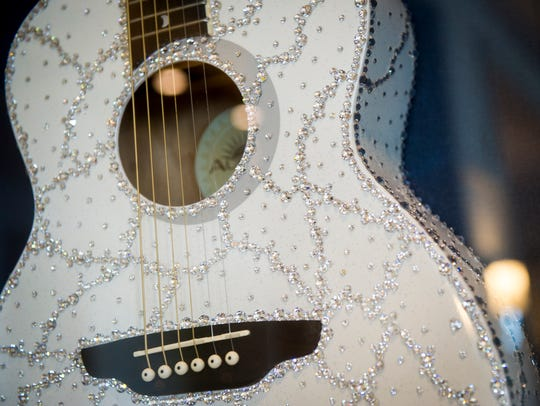 Dolly Parton's Swarovski Crystal guitar on display at Dollywood's DreamMore Resort.