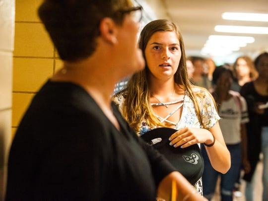 Millville senior Emily Rathgeb chats with teachers before homeroom at Millville Senior High on Wednesday, September 6.