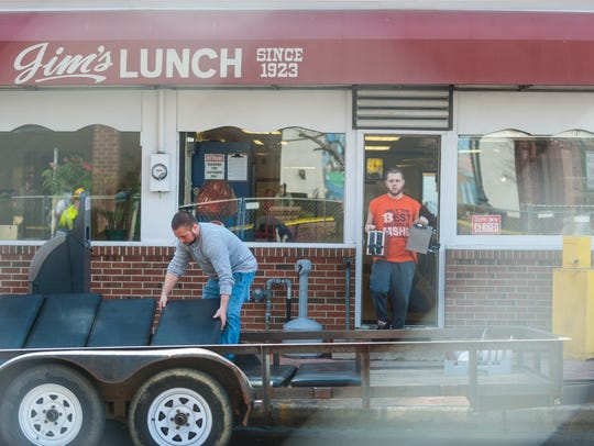 Workers remove belongings from Jim's Lunch on Thursday,