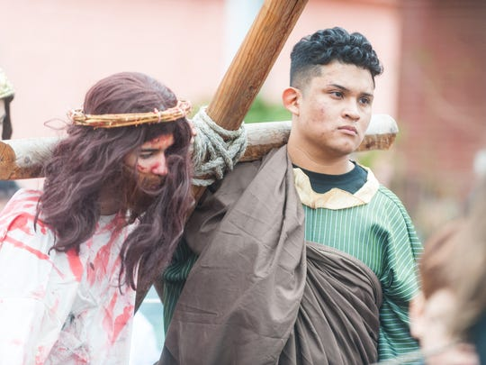 Jesus, played by Darvin Diaz, is helped with the cross