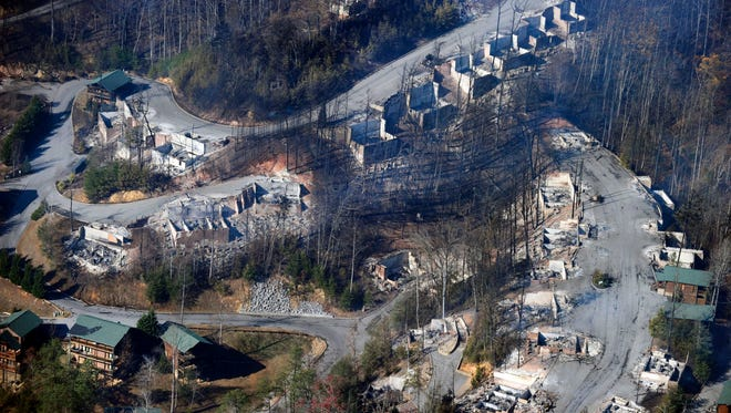 This aerial photo shows, destroyed homes, many burned down to the foundation, Nov. 29, 2016., the day after a wildfire in Gatlinburg, Tenn.