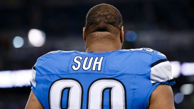 Detroit Lions defensive tackle Ndamukong Suh looks on during warm-ups before a game against the Chicago Bears at Ford Field in Detroit on Nov. 27, 2014.
