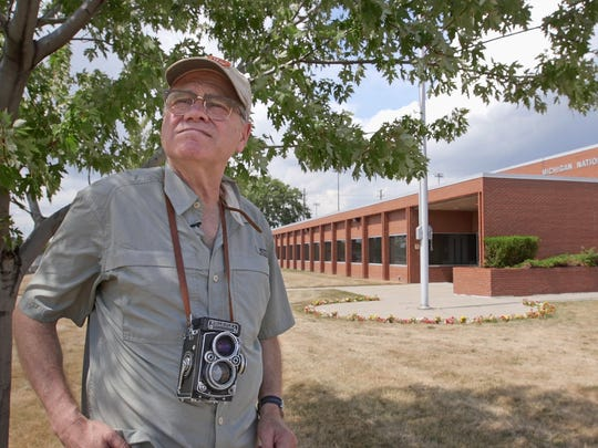 Bearing his old Rollieflex camera, Doug Elbinger of Bloomfield Hills stands at the former site of Olympia Stadium in Detroit, where he documented the Beatles' final Detroit shows on Aug. 13, 1966. The site is now home to a Michigan National Guard Armory.