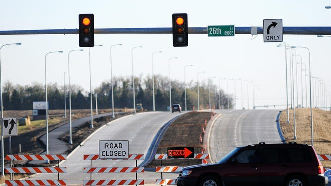 """A """"road closed"""" sign blocks the entry to Highway 11 between 26th Street and 57th Street in Sioux Falls on Friday, Oct. 25, 2013. (Joe Ahlquist / Argus Leader)"""