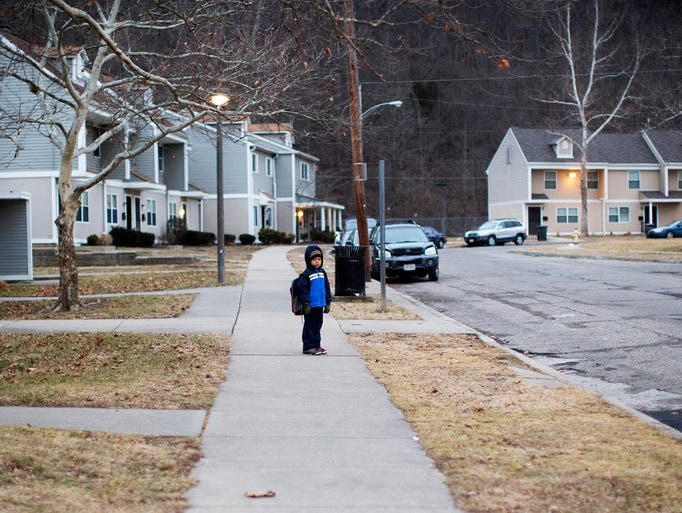 Rayshawn Allen, 5, walks to school each morning with