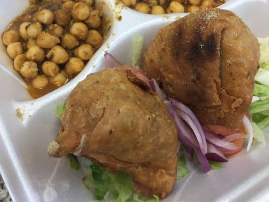 Hot and flaky, potato-packed samosas. They're seasoned with whole cumin seeds and served alongside mild raita at Super Food House, 51 Hornaday Road, Brownsburg.