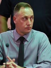 Former Guam police officer Paul John Santos glances