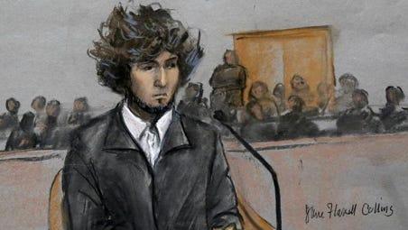 In this Dec. 18, 2014, courtroom sketch, Boston Marathon bombing suspect Dzhokhar Tsarnaev sits in federal court in Boston.