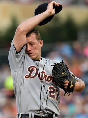 Tigers pitcher Jordan Zimmermann wipes his brow after giving up a single to Twins catcher Jason Castro during the fourth inning on Saturday, July 22, 2017, in Minneapolis.