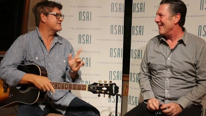 """Monty Powell, left, tells Bart Herbison about writing """"Days Go By"""" with Keith Urban."""