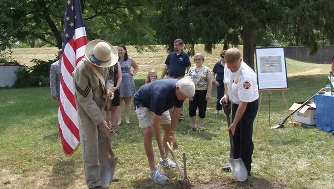 Friends of the Elmira Civil War Prison Camp and local dignitaries break ground for a new building at the former prison camp site.