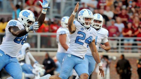North Carolina Tarheels kicker Nick Weiler (24) celebrates