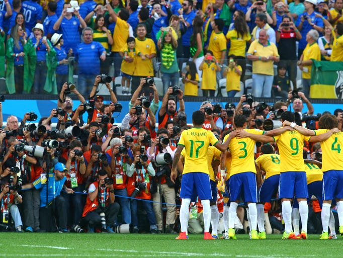 Photographers take a group photo of team Brazil prior to the game against Croatia in the opening game of the 2014 World Cup at Arena Corinthians.