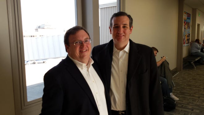 """John Funderburk, director of Advocacy for the Alzheimer's Association, poses for a photo in March with Sen. Ted Cruz, R-Texas, at the Des Moines airport. Funderburk ran into Cruz and introduced himself. Cruz said, """"I need to learn more about Alzheimer's."""""""